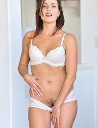 Hi, I'm Helena, a free-spirited Milf with a high sex drive! I had such a fun, orgasm filled day with FTV Milfs! The day started off just right with an outdoor hike. What they didn't know is that I am a nudist, so on my walk, I took it all off! I found a beautiful space to pleasure myself and bring myself to a sublime climax. You wouldn't believe some of the other things I did! On the way back a stop at the grocery store warranted a corn purchase. Yes, my pussy was extremely hungry for that thick cob of corn. I love that full feeling. Maybe it's the Midwest girl in me...I am pretty sure that I could show you that better than I can tell you though;) Another thing they didn't know is that I really enjoy anal! I brought my own set of toys and trust me I was more than obliged to engage in the anal surprise of the day. I can even cum from just anal stimulation. I do enjoy to do myself but sometimes it's even better when someone else is manning my toys for me. As you may already be able to tell, I love experimenting and doing new things. I had an awesome time playing with the vintage gun toy. I've never seen anything like it. I would really love to do another girl with that toy! It was truly an eventful day, since I did all of that and much more. At the end a massage was brought up and I thought wow that would be great at the end of such a long day. I was in for another surprise. Just when I wasn't sure if I could cum anymore, the massage went from tame and relaxing to extreme and delightfully orgasmic. What a pleasant surprise! The final orgasms might have been the best ones in fact. I will never forget that day!