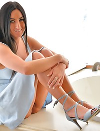So we start the second day with her cutest outfit, the sky blue dress and satin strappy heels; and we decide to get risky and shoot at a busy resort. She's a lot more confident on this second day of shooting, and is coming to learn how to pose, move her figure, and so on. Understand that this resort was full of people, but we tried to go to areas where there were more men sitting about than women. Even so, employees of all kinds would take note of what we were doing. I expected at some point that security would be called on us, and it did after a significant time had passed; so we did get luckier than normal (and even more lucky with how Lia, who was present diffused the situation afterwards off camera -- the manager lady was threatening to have Cecilia arrested). In the beginning, at the lounge area, the guys were cool with it, and Cecilia was flashing in all sorts of ways, even getting more frisky with fingering and spreading -- going beyond the usual upskirt and breast teases. It gets more daring in the reception area, then that sitting area in the balcony, but we were good all the way to when she had her orgasm. One way or another, Cecilia had a exhilarating experience and it gave her that 'adrenaline rush'. This blue dress scene was planned to be her introduction, but we shifted it to be a feature of her part 2 update. We then get back home safely, and she takes those sexy satin heels off... giving one a blowjob, then spreading herself with them, and penetrating herself vaginally. It gets kinkier when she takes a second heel, and pushes it in her anally, ending up double penetrating herself with her heels. Kinky & sexy for sure... Keeping up with the dress & heels theme with this update, we enjoy watching her play pool in her super sexy dress and gold heels. Of course, it slowly becomes a teaser session, exposing those glorious breasts and her firm butt. It leads to more masturbation, with a good angle to get her strong vaginal contractions on orgasm. Two separate videos get the action. We are back out again, and she's wearing a rather exotic pair of light pants and just a bra (which was her mom's by the way) and she starts dancing on location to the music in the background. It's one of those restoration garages, which stores & restores classic cars. We got access to it and had her pose with the classic red firetruck, getting naked and fingering herself. That girl is always wet and juicy... So no lube required when she pushes that big portable magic wand head into her vagina, and starts fucking herself with it. She ends up having another orgasm (losing track of how many she's had over the weekend!) and when she pulls it out above me, some of her juices drip onto my arm. She rubs the rest onto her nipple. The last video is a sort-of outtake where Lia took over the shooting, and did a little dressup scene, trying on different biknis, and playing with a glass toy. Now she's supposedly got a cute friend that also has big breasts like hers back in Ohio, so I'm hoping to encourage the friend to come, and we can continue this busty trend...