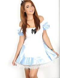 Stunning Alluring Vixen babe Lilly shows off her Alice In Wonderland costume with no panties underneath