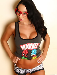 Busty Alluring Vixen babe Jen makes being a comic book nerd very sexy in her lowcut tank top