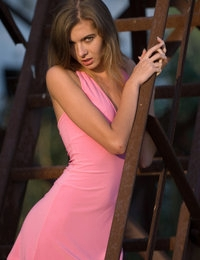 Admirable slim cutie strips down her pink summer dress and reveals her gorgeous nude body.