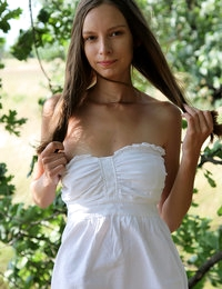 Beautiful long haired girl with impressive breasts demonstrating her sweet pussy outdoor.