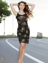 Cute long haired bombshell undressing and demonstrating naughty quim outdoor in the field.