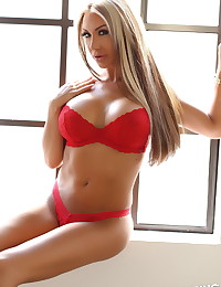 Busty blonde Alluring Vixen babe Kimmy teases in her skimpy red lace bra and thong undies that leave little to the imagination