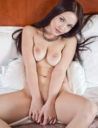 This naughty sweetheart likes to play with her busty tits, especially in front of the hungry camera lenses. Amazingly hot nude model.