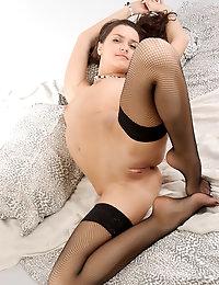 Roza in black fishnet thigh highs.