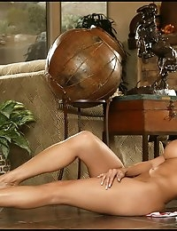 What do you get when you put a dark-eyed, beautiful girl in a slinky, low cut, red evening dress? Of course you get a whole lot of eye candy -- especially when the girl is the lovely Lucia Tovar. As you know, we don't have a Foxes Babe of the Month contest; but we just may start that up soon. If we did, this month's choice would have to be Lucia. She modeled this set for us to be used exclusively for Foxes.com. She is definitely a babe!