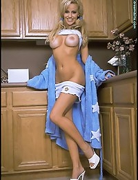 The ultimate Dream Doll, Cory looks both cute and very sexy in her blue robe with a girlish top and shorts underneath. As she disrobes, her body jumps out at you and her smile melts you with its charm. See her go from playful to provocative in Cory Kitchen Romp