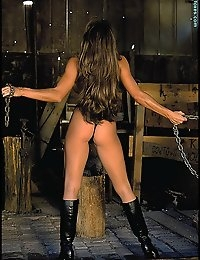 Starting with a leopard-print top and blank thong bottom, Carla goes topless in a blacksmith's shop. This set of photos is the last we have on Carla, and includes some classic shots of Carla stretching with rusted chains. If you are a collector of Carla Holmes photos, you will want to get this specially priced set.