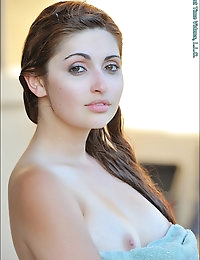 This super gorgeous girl is half Persian, half Italian, and is so innocent to her sexuality that she's only had 2 boyfriends, and never even masturbated before! No doubt her total first time experience in adult. Her name Laleh means Tulip in Persian. We meet her at a restaurant, and watch her flash her perfect round natural breasts for the first time, then undress for us and do a timid nude photoshoot. Then then masturbates with a vibrator for the first time, and surprises herself with a satisfying orgasm. It brings her out of her shell, and makes her more giggly... Then we get extreme closeups of her private parts, her vagina is so tiny... and wet! She tries on a cute bra & panties for us, then does a hard breast and butt massage. Some of the most perfect round & firm natural breasts we've ever seen! She also has some of the prettiest feet we've ever seen, so we watch her play with them, and massage them throughout the shoot. Then in a sexy outfit and black heels, she uses the Eroscillator toy, and then tries a large dildo that barely gets the head inside her. Next morning with her hair curled, she masturbates again to orgasm, then goes out for clothes shopping. She flashes all over the mall, and tries on new cute dresses & heels for us. Back home, she uses an egg-vibrator to show how tight she is, and how she can hold it in, as well as push it out with her tight vaginal muscles. More extreme closeups show how wet she is, and how her sticky juices end up all over her fingers, especially after she tries penetrating with four fingers. On in the summer heat, she walks naked and flashes some more, then goes home in her teddy and her hair up to get more kinky with 3 bullet vibrators in her vagina at once. To end the day, this natural beauty cools down in the pool, and does another sensual photoshoot. Gorgeous, tattoo-free, and with those big inviting eyes, she will mesmerize you...