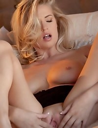It's okay to look long and hard at Alexa Johnson as she rolls around in bed wearing little more than thin, revealing lingerie. Her breasts are soft and perky, with sweet little nipples peeking through the sheer material of her corset. The thought of you watching her strip down is getting her so excited, watch as she masturbates on her sumptuous-bed spread to the brink of a delicious orgasm.