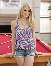Blonde hottie gets naughty on a pool table and spreads her pink twat