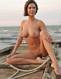 """This week's Best of Femjoy features the astoundingly beautiful and sexy SUSI R. in """"Pleasure Island"""". Needless to say, what makes this island a pleasure is Susi herself. In the short time that this amazing amazon has been gracing our pages, she has made a big impression. The responses have been incredible, and deserving. The fact that she as beautiful on the inside as she is on the outside makes a lot of sense, and proves the theory that beauty comes from the inside out. Never has that been more true than with Susi.But don't just take our word for it - here's what our members had to say about this Femjoy beauty and her island excursion;""""Beautiful model - awesome set. I love the confident look this model possesses. Gorgeous. 10 stars for her and photog.""""""""Oh boy she is one of the best ever!""""""""Susi, what a wonderful image. You are beautiful and have given us a great gallery. It is a wonderful privilege to be able to admire the lovely naked buttocks of a gorgeous girl. Thanks, Susi. You are delightful.""""""""Excellent set!""""""""Unbelievable perfection!! 6 stars******""""""""I am speechless. For me, Susi is perfection. Wow. Thank you.""""""""Perfect!!""""""""This presentation, photo session, combines all the right elements in the perfect mix. The background adds not only texture, but feeling, and in such a way as to enhance the beauty of an already beautiful woman. My complements to Susi and photographer Wildhan.""""""""Just a heavenly woman !""""""""What a great set. Gorgeous Susi. A favorite from her first gallery! """"""""Susi, You are breathtakingly beautiful... very natural look.""""""""She is a dream.""""""""She is absolutely stunning! What a great set.""""Well said members, and thanks for sharing. We know she will appreciate all of the wonderful compliments, which only serve to confirm our decision to name her this week's Best of Femjoy. We hope to continue to bring Susi to you in all her glory. Until then, please enjoy this, as well as her other sets with Femjoy as they are all beautiful - because she is in them. Enjoy! :)"""