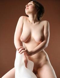 Busty babe Hope feels amazing while posing nude