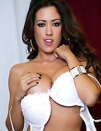 Busty brunette Capri Cavanni slowly slips out of her white bra and panties.