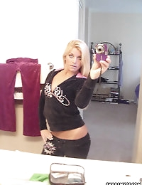 Blonde slutty girlfriend takes selfshot mirror pictures of her small tits and freshly shaved pussy