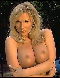 Leslie begins wearing a pretty leopard print dress with a black top. She's out in the backyard. Before long Leslie is removing the dress and her body looks so good. Large round breasts, nice shave, beautifully tanned body are all in full view.