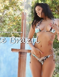 Abby Lee Brazil takes an outdoor shower