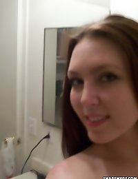 Perfect girlfriend shows off her perky real tits as she takes naked mirror selfshot pictures