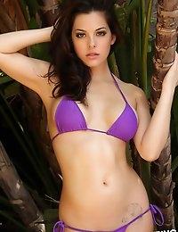 Alluring Vixen tease Olivia shows off her delicious curves in a skimpy purple string bikini