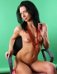 Sandra sits on the chair nude and lovely in her beads showing cunt