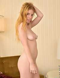 Pretty redhead amateur Alexia Silvers plays with her furry pussy