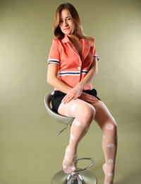 Adele wears orange top, mini skirt and patterned pantyhose for pussy shot