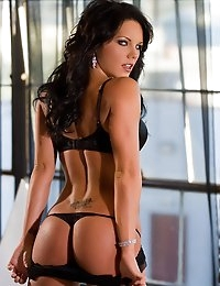 Beautiful Cali Taylor stips in front of a window.