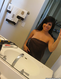 Busty latina girlfriend shows off her huge perfect tits in the bathroom