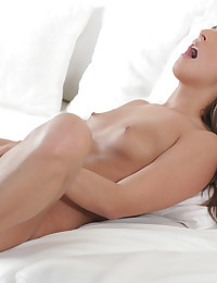 Join brunette babe Amira Adara and watch her finger and fondle her dripping bald pussy with her long talented fingers