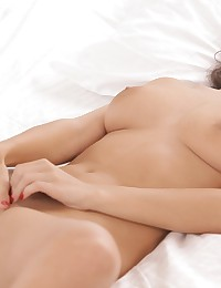 Tantalizing April Oneil enjoys her own gentle touches as her fingertips delve into the silky wetness of her womanhood