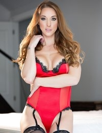 Courtney Shane in a satin red corset and stockings