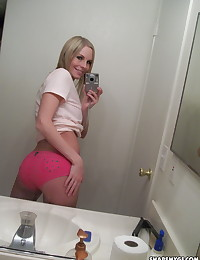 Blonde busty girlfriend takes selfshot pictures in the mirror for her boyfriend