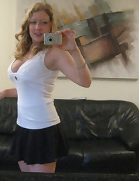 Busty blonde girlfriend shows off her huge tits as she takes selfshot mirror pictures