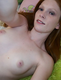 Skinny ginger girlfriend takes selfshot pictures of her small perky tits and tight little pussy