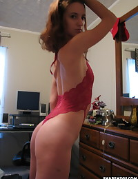 Skinny horny girlfriend takes selfshot pictures as she strips out of her slutty skimpy red lingerie