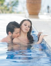 Relaxing in the resort's infinity pool, Martina Gold felt every ounce of tension slip away into the distance. When Joel slipped up behind her to surprise Martina with a kiss on the neck, and his pawing hands all over, her body responded instantly with a shiver of inflamed lust. Martina got up on the side of the pool and pulled her bikini bottom aside so Joel could give her pussy a slow lick right up the middle, and tease her with tongue right on her clit. And when Martina was horny for his fat cock, she slipped back in the water so Joel could dive inside her from behind. Craving something more, Martina got on the deck and took a breath while Joel pressed the tip of his dick against her tight asshole, before taking him balls deep for an al fresco anal fuck in the afternoon sun!