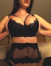 Katherine Knowles teasing in black lingerie and stockings